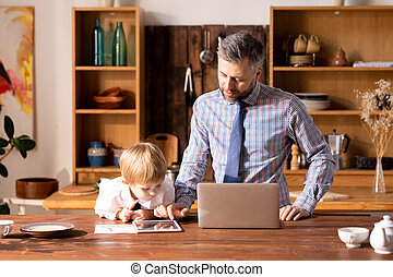 Father showing tablet app to son