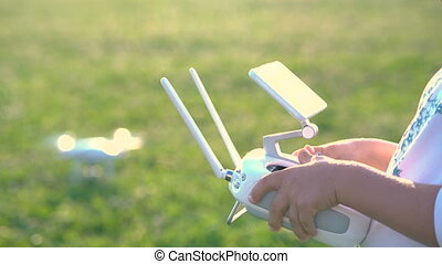 father shows his daughter how to control drone outdoors