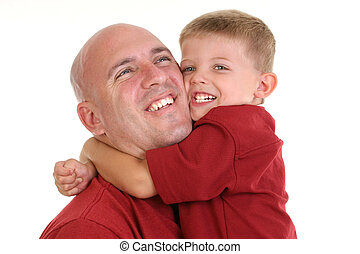 Father Son Family - Four year old boy hugging his dad around...