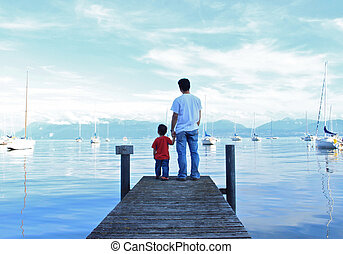 Father and Son along the Lake Geneva on a sunny day.