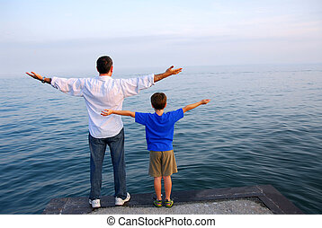 Father son ocean - Father and son on a pier relaxing ...