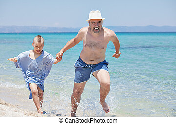 Father Son Running Seashore