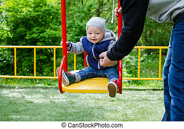Father swinging his baby