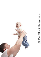 father swinging his son with joy