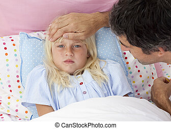 Father taking his daughter\'s temperature in bed