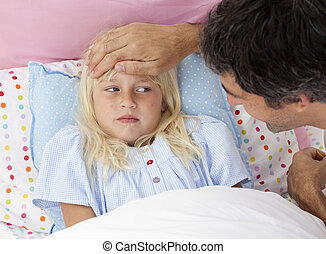 Father taking his daughter\'s temperature lying in bed