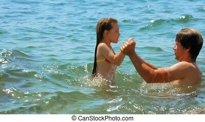Father Teaches Daughter To Swim