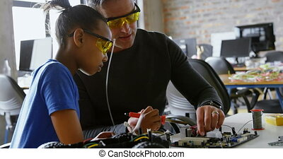Father teaching her daughter about soldering iron 4k
