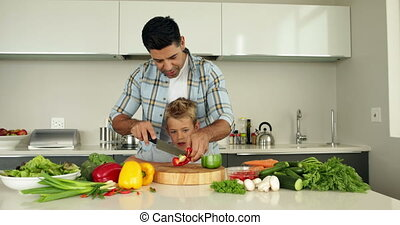 Father teaching his son how to chop
