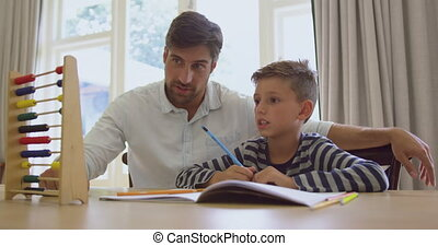Father teaching his son mathematics with abacus in a comfortable home 4k