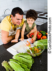 father teaching toddler son cooking - happy father teaching ...