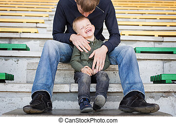 Father tickles his son