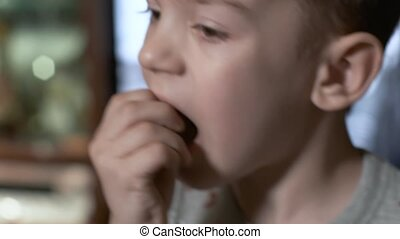 child opens mouth with black decayed teeth. closeup on father's hands trying to pull out his little son's wobbly tooth, dad pulling shaking tooth. caries, oral and dental hygiene, health care
