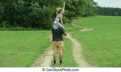 father walking road daughter sitting on his neck