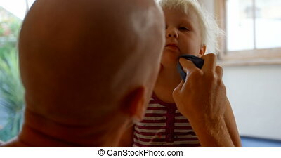 Father wiping his daughters mouth 4k - Close-up of Caucasian...