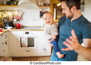 Father with a baby girl at home.