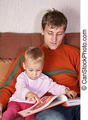 father with baby and book