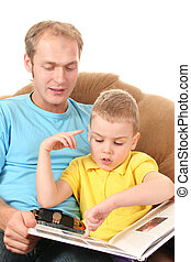 father with boy reading book