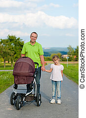 Father with child and baby buggy - Father with child and a...