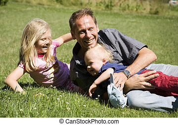 father with children - father playing with his son and...