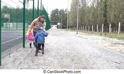 Father with children playing in the baton