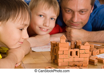 Father with children playing