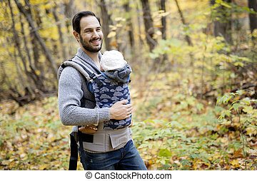 Father with daughter baby in autumn forest