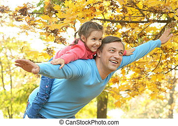 Father with daughter in  park