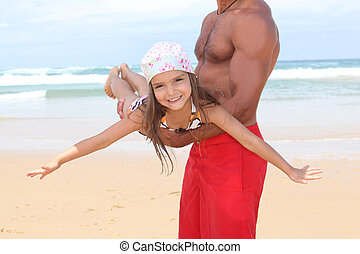 Father with daughter on beach