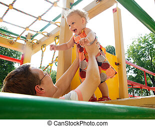 Father with daughter on playground