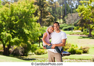 Father with her daughter in the park