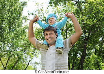 Father with his baby boy outside
