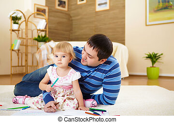 father with his little daughter at home