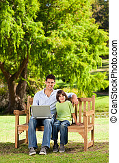 Father with his son looking at their laptop