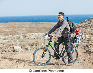 Father with his son on bike