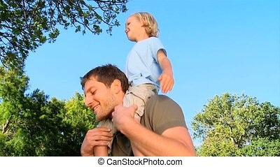 Father with his son on his shoulder