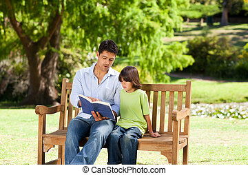 Father with his son reading a book