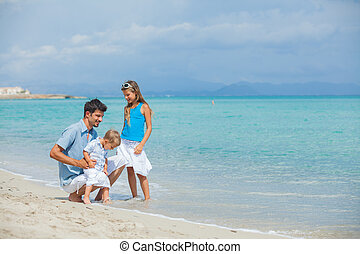 Father with his two kids on beach