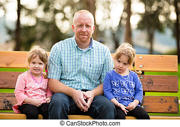 Father With Identical Twin Daughters