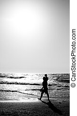 father with kid on the beach