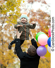 father with little child - happy father toss up little child...