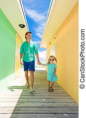 Father with little daughter walking on caribbean island