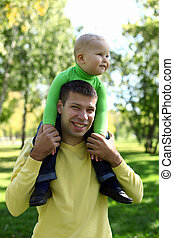 Father with little son in park