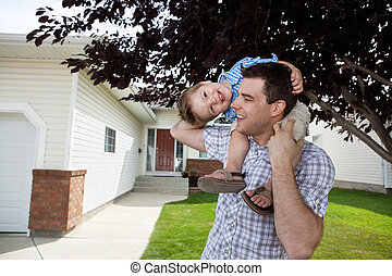 Father With Little Son on His Shoulders