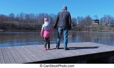 Father with small daughter on the raft