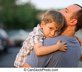 Father with son - Little boy hugging hugging father around...