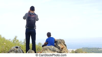 Father with son looking at the city below