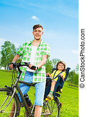 Father with son on a bike