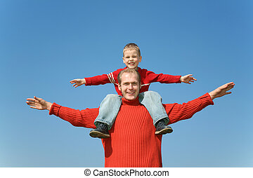 father with son on shoulders 2
