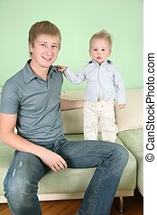 father with son on sofa